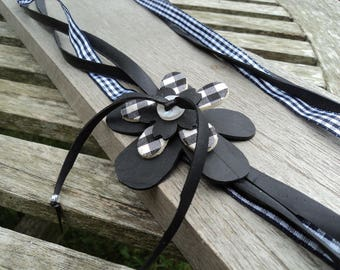 Necklace made with recycled tractor inner with flower and black and white gingham Ribbon