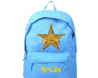 bag has blue sheriff star personalized with name