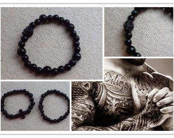 """Man bracelet"" black wood beads along with a howlite skull"