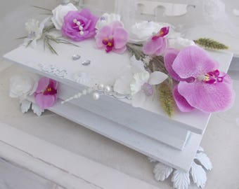 urn wedding trunk white orchids