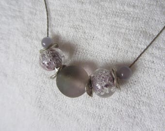 simple and elegant necklace with purple handmade glass beads and silver snake chain