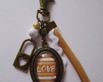 "Lucky charm ""Precious love II"", bronze cabochon, costume jewelry"