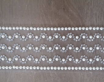Rhinestones and half white pearls and silver
