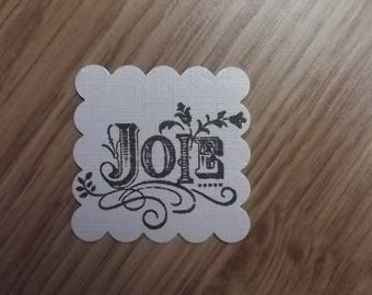 "10 tags ""joy"" in the colors of your choice for your scrapbooking creations."