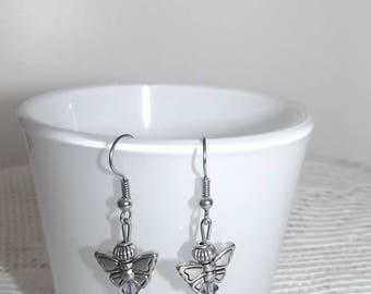 Swarovski pearl earrings.