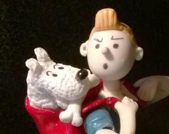 Decorative figurine: tintin is not happy with his dog in cold porcelain.
