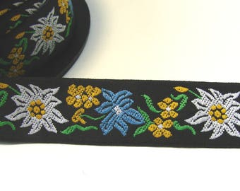 Woven Ribbon, 20 mm, edelweiss, blue, white, yellow, green, black background, sold by the yard.