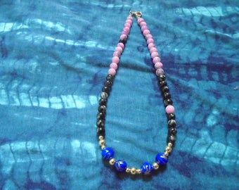 10% off Asymmetrical pink, black, and blue beaded necklace