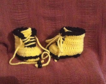 yellow and black baby booties size 3 to 6 months