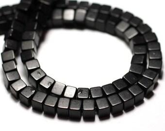 Fil 39cm 98pc env - Perles de Pierre Turquoise Synthèse Cubes 4mm Noir