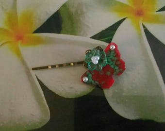 a Bobby pin brass loafer butterfly and flower
