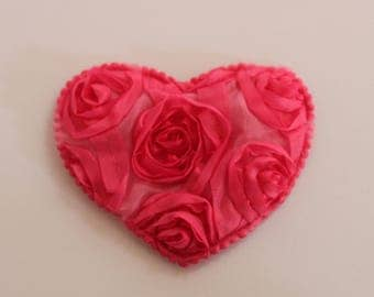 very pretty pink heart with flowers in relief