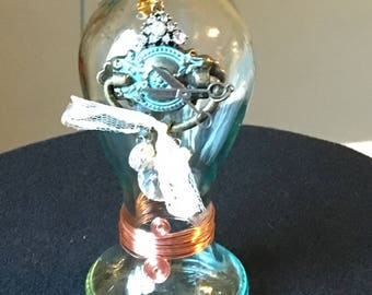 Steampunk embellished bottle