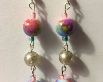 Multi color beads and silver earrings.