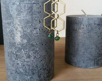 Earrings shaped hexagonal with a green Christmas tree bead