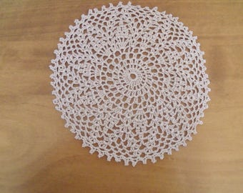 beige crochet doily
