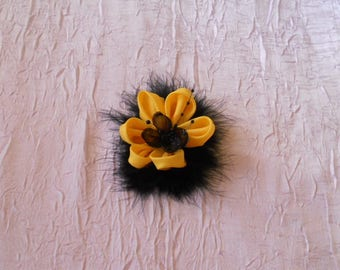 Clip black and yellow flower and feathers