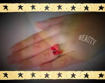 silver plated ring with a red polymer clay and its shiny black bow