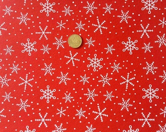 1 sheet of red felt and white snowflakes 30 x 30 cm