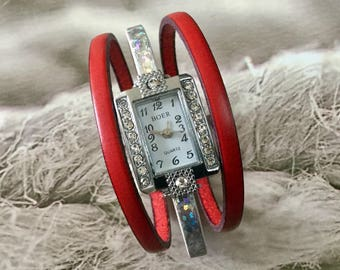Woman shows fancy watch rectangle rhinestone leather strap and metal shiny silver and Red