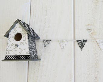 Decorative birdhouse, wall decor and its Garland of flags