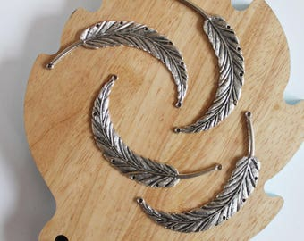 Large silver metal feathers