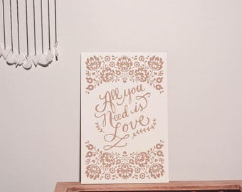 """Large wooden card engraved """"all you need is love"""""""