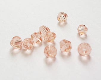 set of 20 Crystal beads, salmon pink clear, 4mm bicone