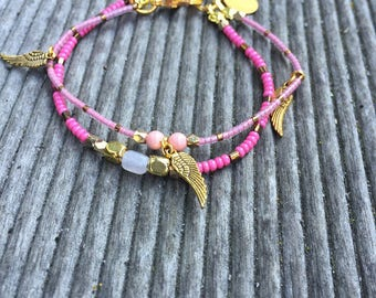 Bracelet two rows of pink and gold beads with charms