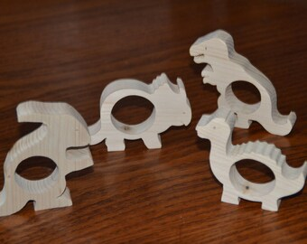 Set of four napkin rings in the shape of dinosaurs