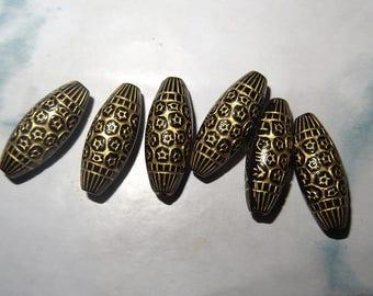 6 oval beads black pink leaf dorees.fleurs Dimension: 22mm x 8mm. Hole: 1 mm (crossing thread)