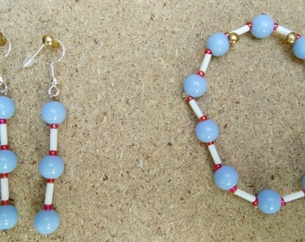earring set in silver and pearl bracelet.