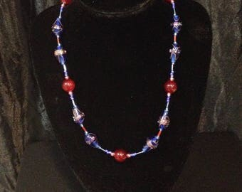 Crimson red beads and dark blue glass beads matinee necklace