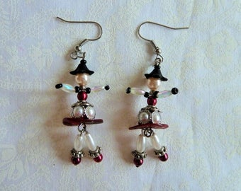 Jointed miniature dolls red metal and mother of pearl beads earrings