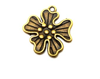 bronze coloured metal flower charm