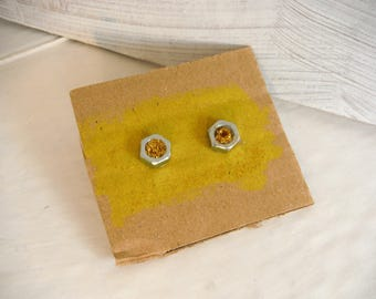 earrings with gold glitter and nut/bolt earrings