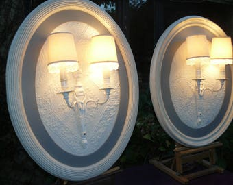 Wall framed in oval frames painted off-white, white fabric
