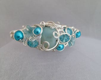 Silver plated non tarnish wirework cuff, with amazonite focal bead.