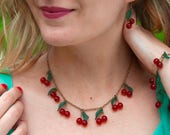 Cherry necklace with green leaves dark metal color bronze
