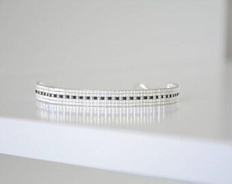 Bracelet woven with Miyuki Delica silver white transparent and black