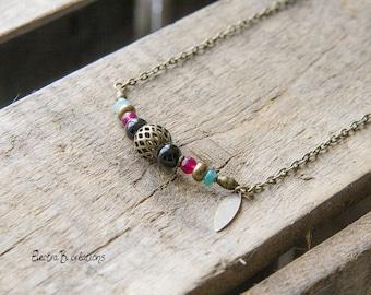 Fine bohemian necklace made of gemstones, black, raspberry, turquoise, bronze