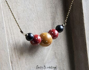 The Choker beads with mustard yellow polka dots, red and black onyx
