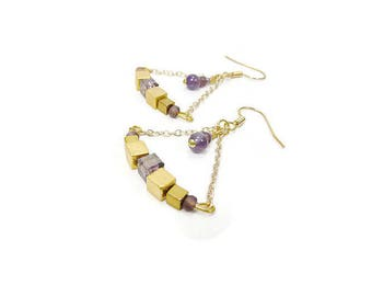 Earrings are made of amethyst and Crystal gold plated cubes