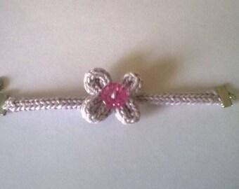 Bracelet made by knitting cotton yarn.