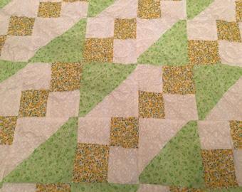 Yellow, green, & white lap quilt w subtle flowers