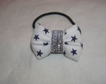 scrunchy with a white fabric with Navy stars bow