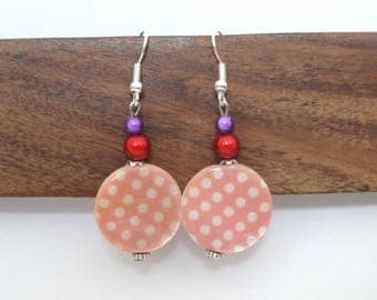 Pink dangle earrings with white polka dots