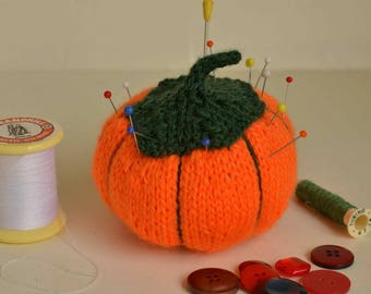 Miss 2 orange pumpkin pin cushion