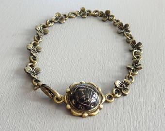 Bracelet fancy sophisticated black and gold vintage style
