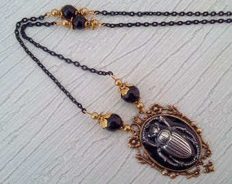 Old style with a scarab beetle pendant necklace